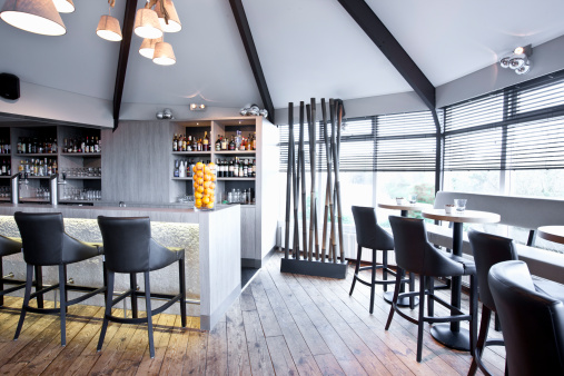 Bar and tables in modern restaurant